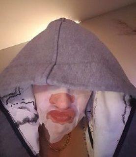 Danae wearing a pampering facial mask and a MACq 01 Hotel robe