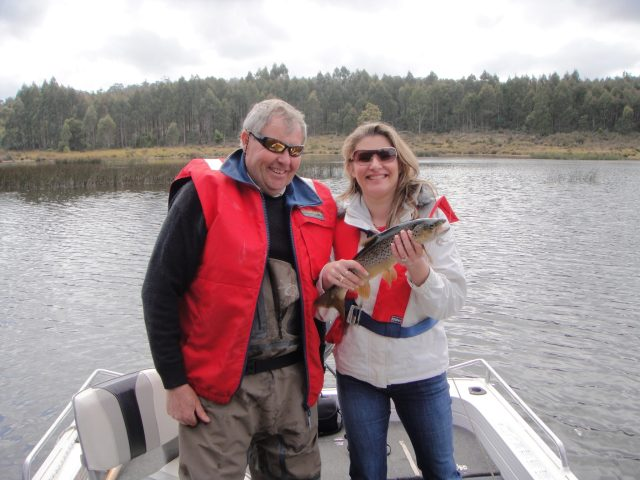 Danae with a fine trout and Phipps Onslow, guide