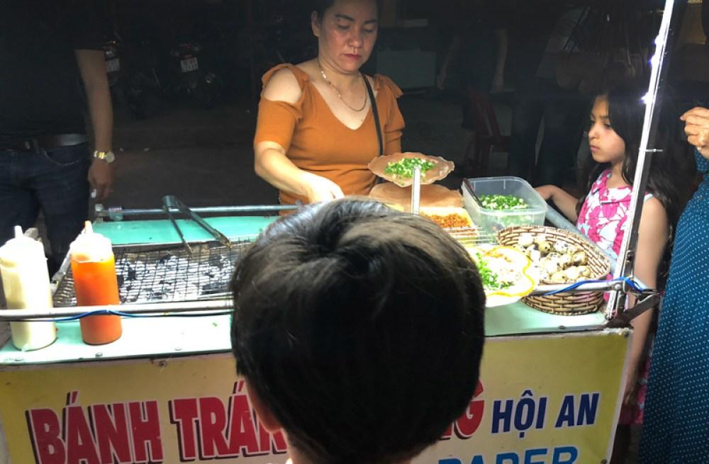 A street vendor in Hoi An