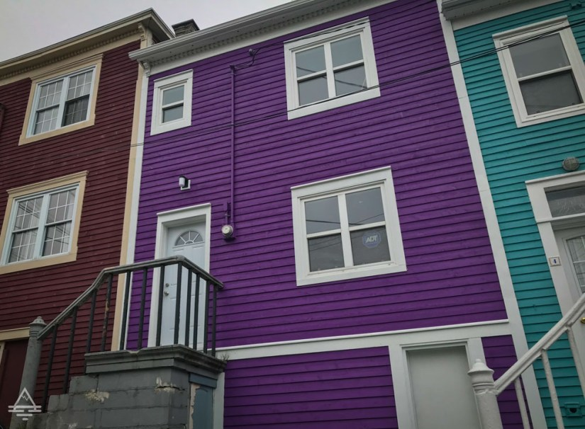Three residences in St John's, Newfoundland in bright colors.
