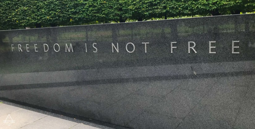 Wall with Freedom is Not Free Carved in Stone