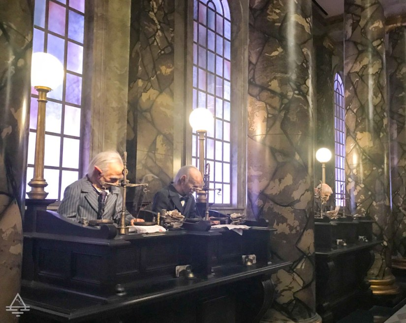 The Goblins working in Gringotts Bank in Harry Potter World Orlando.
