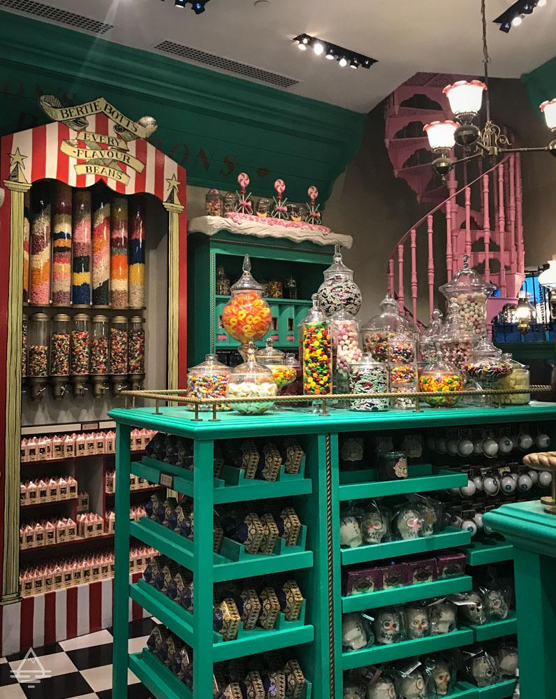 Shelves of candy inside of Honeydukes in Harry Potter World Orlando