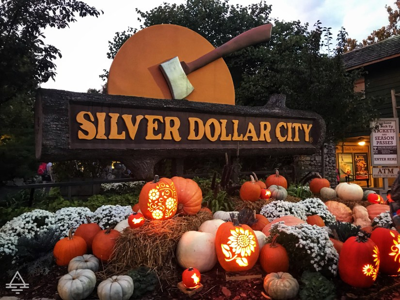 Silver Dollar City Sign with pumpkins surrounding it