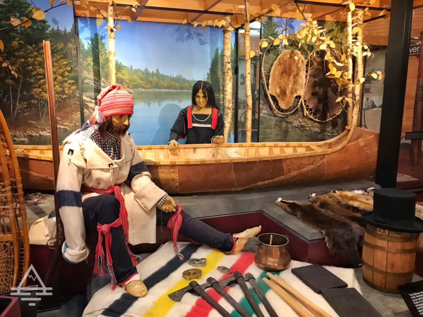 Exhibit showing a voyageur and a canoe.