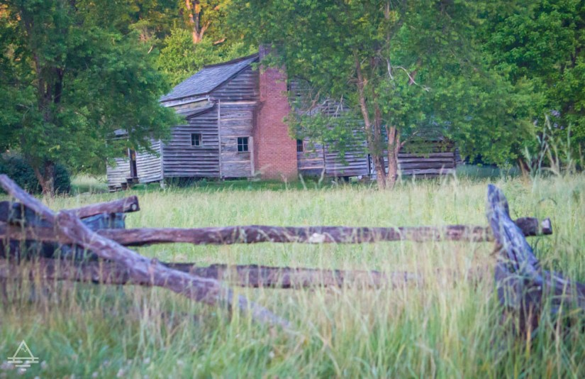 Historic cabin with fence in Cades Cove