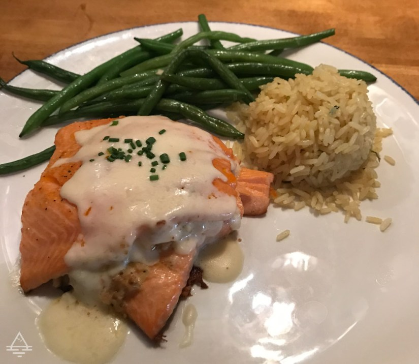 Plate of stuffed salmon, green beans, and rice at Landry's in St Louis