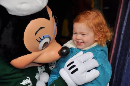 V meeting Minnie Mouse on Disneyland trip #2, December 2011.
