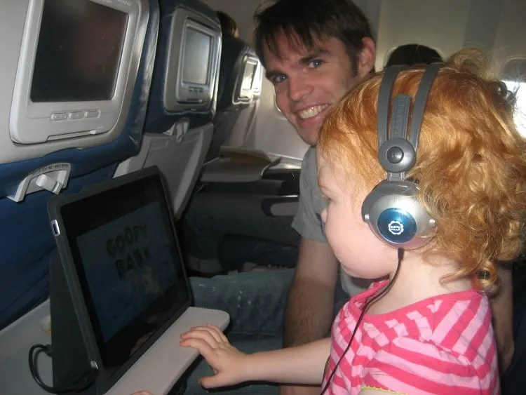 NonStop vs. Connecting Flights with Kids - iPad on Plane