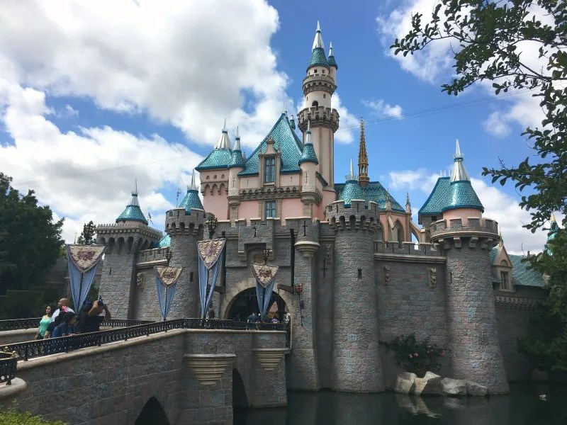 Explore Sleeping Beauty Castle on a crowded Disneyland day.