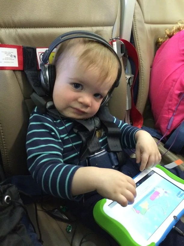 How to Survive Flying with a Lap Toddler - Trips With Tykes