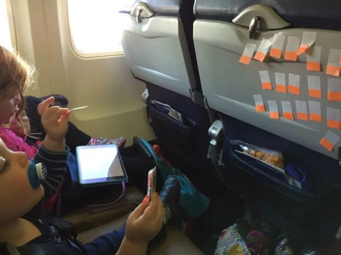 How to Survive Flying with a Lap Toddler Post It Note Games