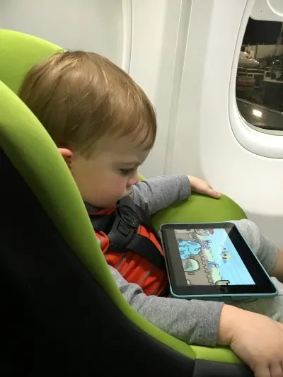 Best and Worst Ages to Fly with Kids - Toddler on Plane in Car Seat