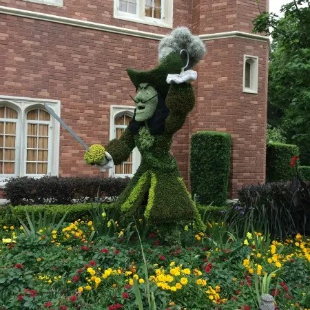 Peter Pan and Captain Hook topiaries do battle in the Epcot International Flower & Garden Festival.