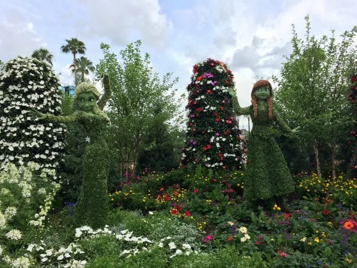 Anna and Elsa topiaries delight Frozen fans at the Epcot International Flower & Garden Festival in Walt Disney World.