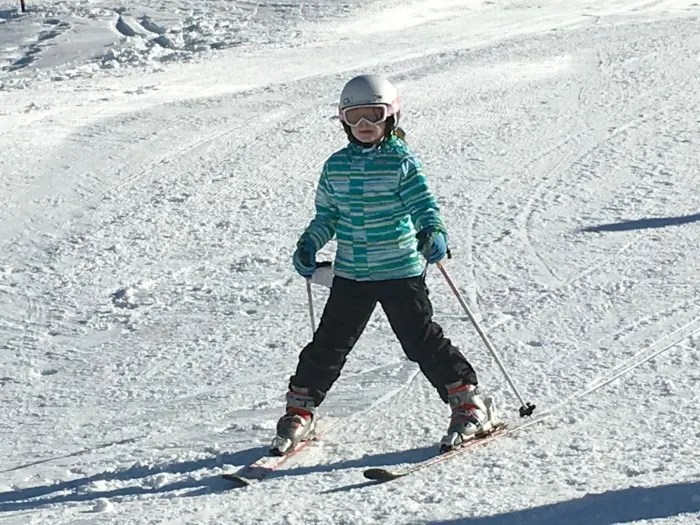 Money Saving Ski Tips - child skiing