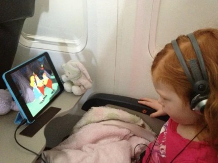 Summer Air Travel - Child on Plane - 1