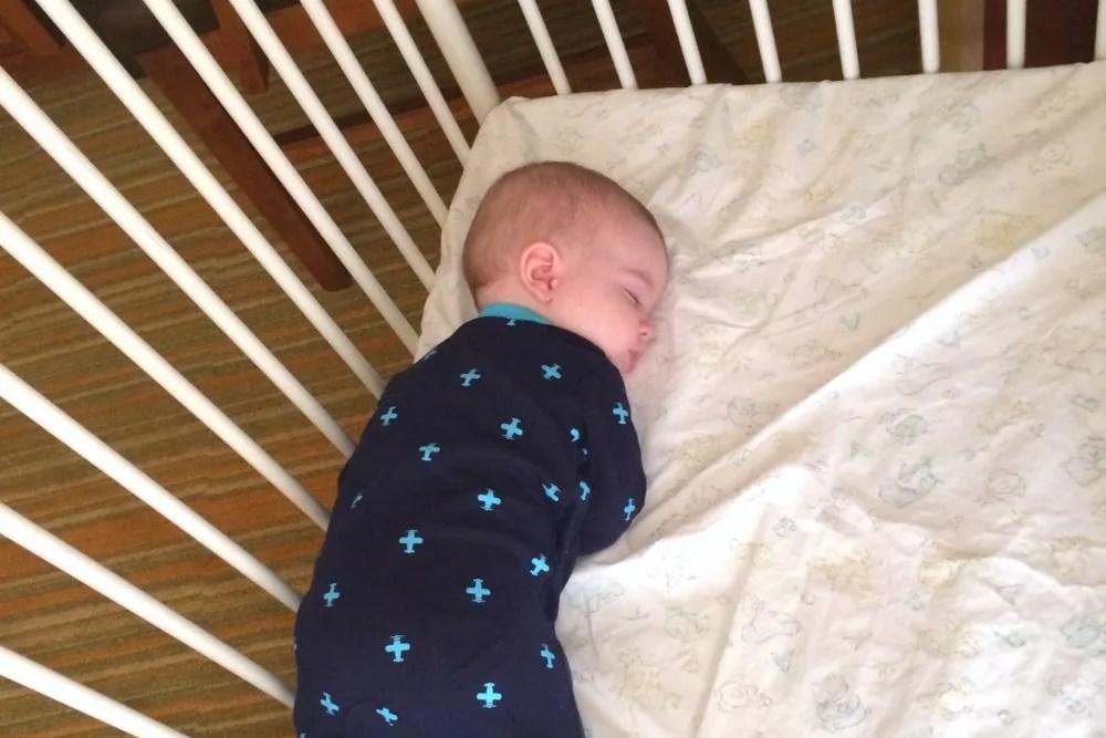 Baby Asleep in Hotel Crib
