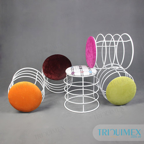 Wrought iron garden stool with colorful cushion
