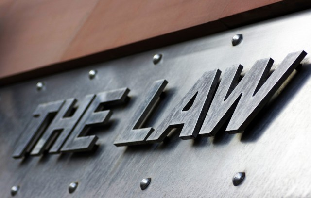 "A photo of steel brushed letters spelling out ""The Law"""