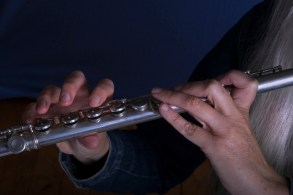 Close-up of Trisha playing her flute