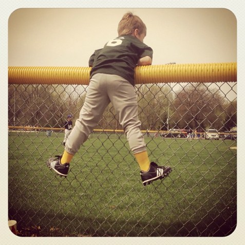 isaiah on fence