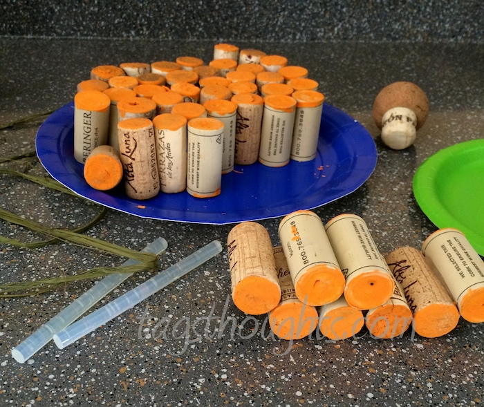 corks with orange ends on a dark surface