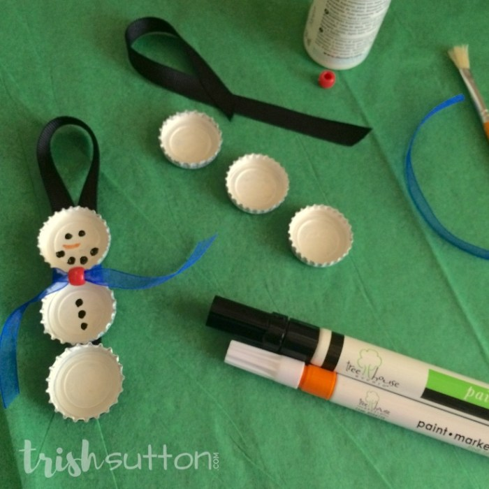 Upcycle bottle caps to create cute Christmas tree ornaments. This simple creation is perfect for kids & adults alike. Bottle Cap Snowman Ornament. TrishSutton.com