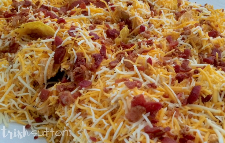 pan of buffalo ranch chicken baked nachos ready for the oven