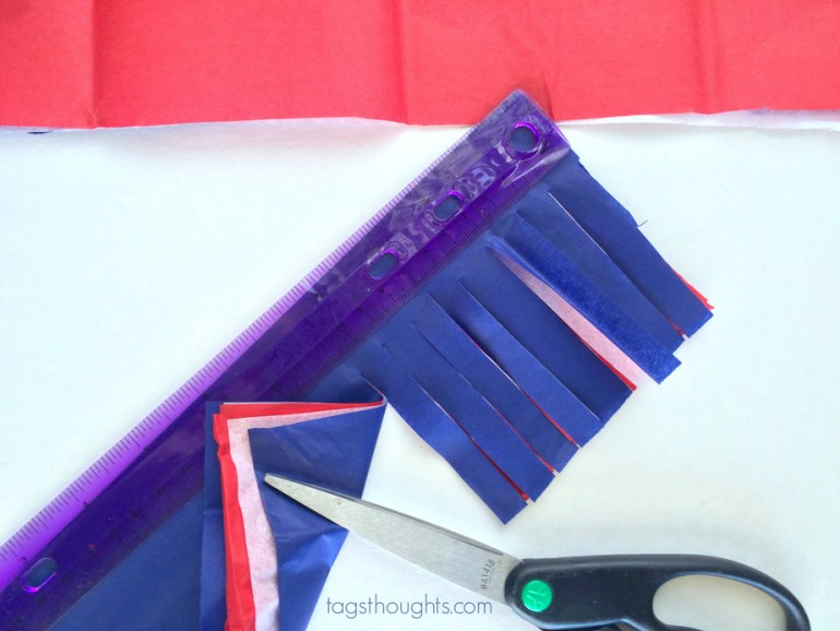 Red, white & blue tissue paper cut with scissors for sparklers.