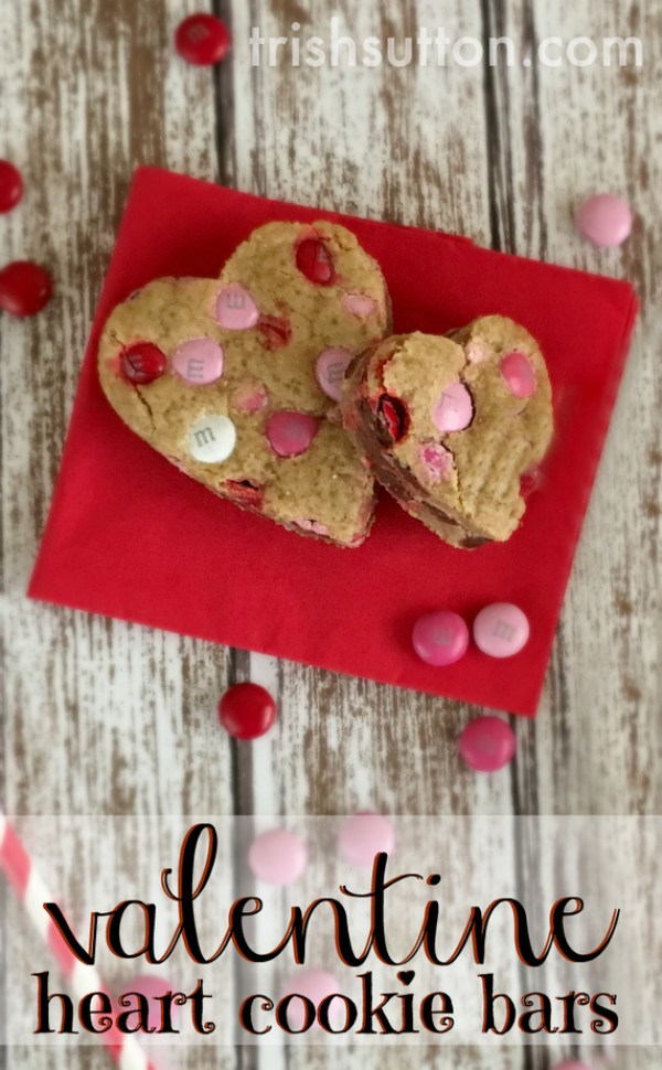 A sweet way to share your love on Valentine's Day is by way of Valentine Heart Cookie Bars! A recipe made with a lot of love & a lot of pink & red M&Ms. TrishSutton.com