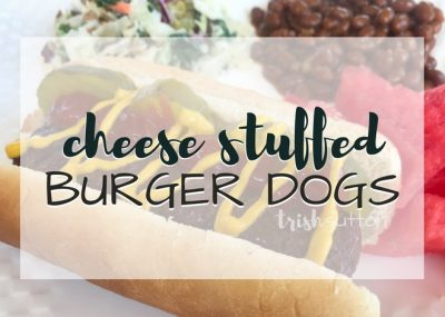 Backyard BBQ season has arrived! If cheeseburgers are on your grill menu you must try this twist; Grilled Cheese Stuffed Burger Dogs. TrishSutton.com