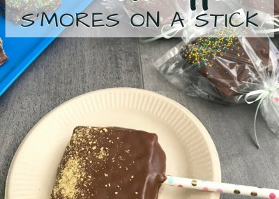 Chocolate Dipped S'mores. Perfect for parties! Amazing graham cracker, marshmallow & chocolate dipped sandwiches - Chocolate Dipped S'mores on a Stick.TrishSutton.com