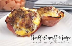 breakfast muffins made with eggs, bacon, ham & cheese on a white plate; overnight breakfast recipe