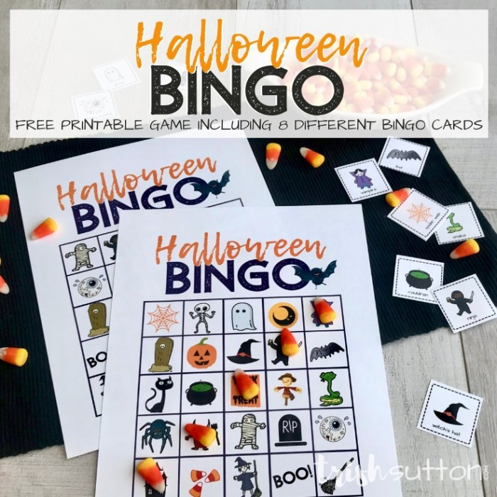 Halloween Bingo Cards on a black mat with candy corn bingo markers