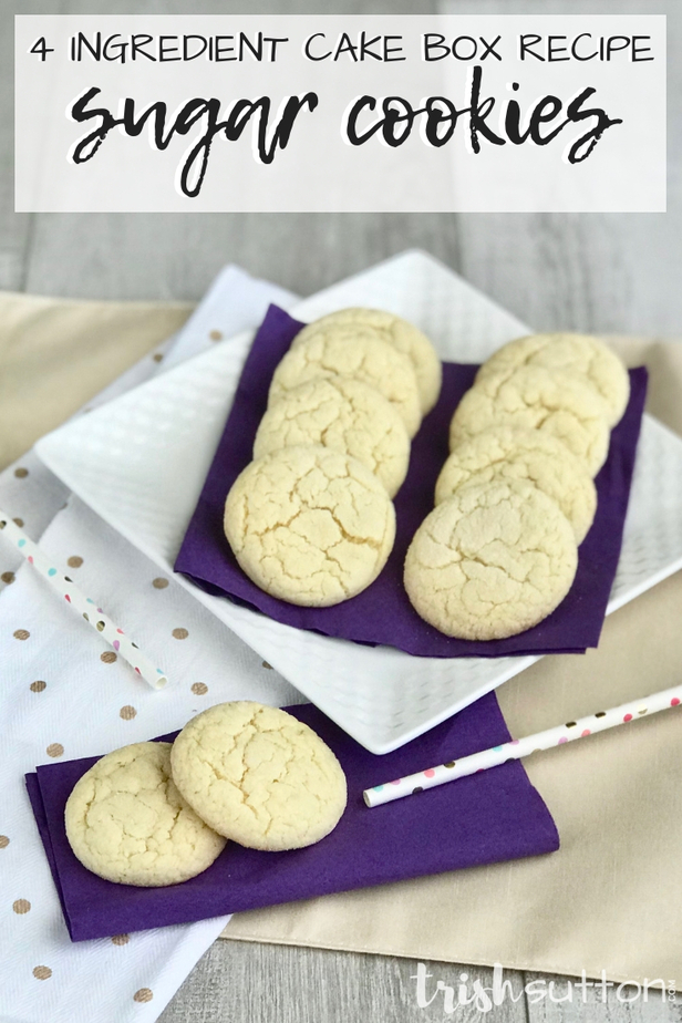 sugar cookies on a white plate with two cookies on a purple napkin