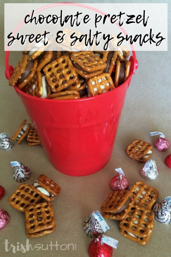 red bucket filled with chocolate pretzel snacks