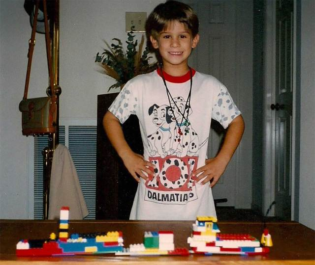 Tristan Mace as a young child with Legos.