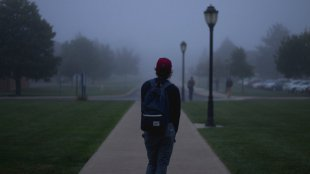Sad semester student wonders what to do in the fog of life.