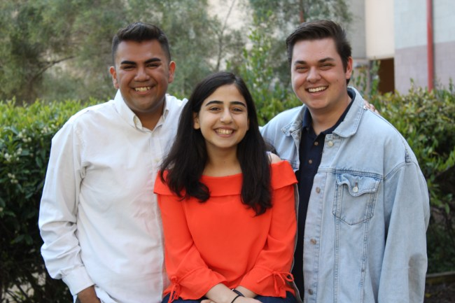 Adán Chávez (left) and Matthew Arrollado (right) stand behind Tara Vahdani. AJ Peterson / The Triton.