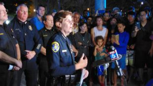 San Diego Police Chief Shelley Zimmerman speaks to reporters outside the apartment complex. Chris Jennewein / Times of San Diego