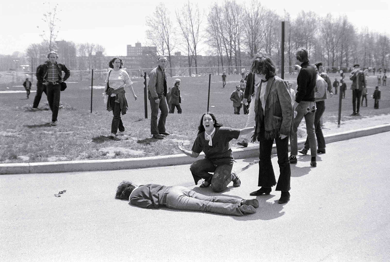 14 year old runaway Mary Ann Vecchio kneeling over the body of Jeffrey Miller who had been fatally shot minutes before. (John Filo, Valley Daily News)