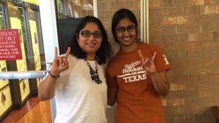 Helmet Javeri (left) with a student at UT Austin. Photo from Hemlata Javeri's Twitter profile.