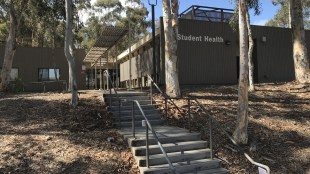 Photo of the Student Health Services Urgent Care building on Library Walk