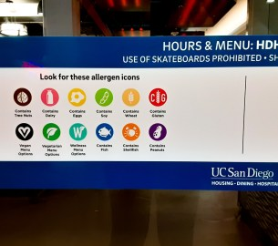 Photo of UC San Diego Housing, Dining, and Hospitality dining hall food allergen icons.