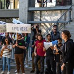 Photo of students on strike in support of a Cost of Living Adjustment in front of Gilman Parking Structure at UC San Diego.