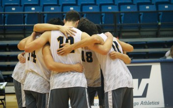 A UCSD basketball team huddles up.