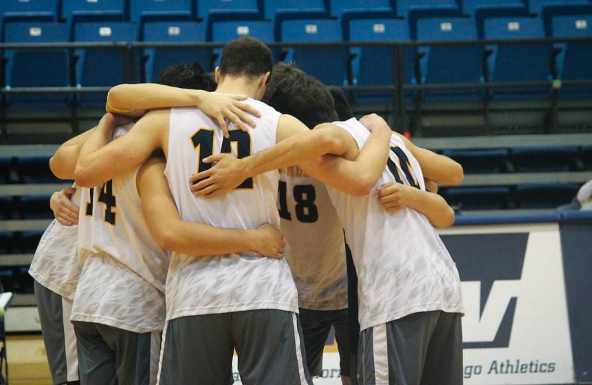 A UCSD basketball team huddles up.