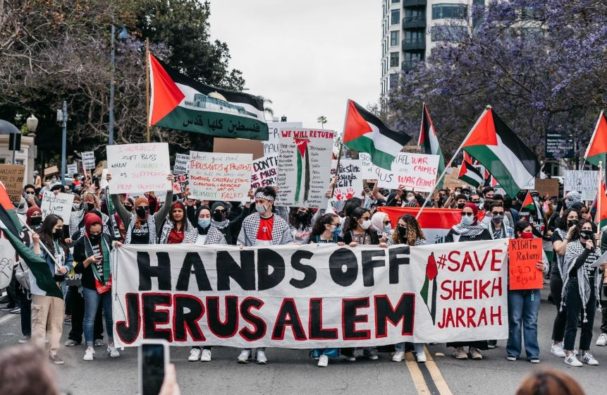 """Photo on sign reading """"hands off Jerusalem"""""""