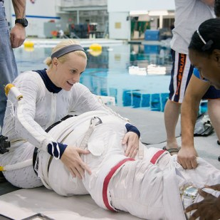 Rubins trains for a spacewalk at the Johnson Space Centers Neutral Buoyancy Laboratory.